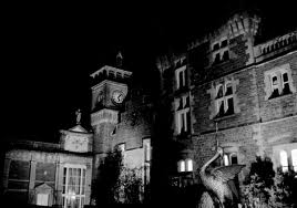 Craig y Nos Castle clocktower and theatre, South Wales, at night
