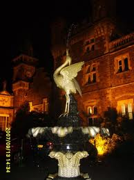 Fountain at haunted house Craig y Nos Castle, Swansea, Wales at night