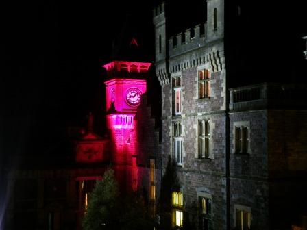 Haunted House Craig y Nos Castle at night clocktower in pink, Halloween Fright Night in Powys, Wales