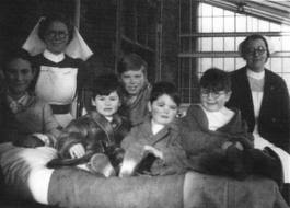 Nurses and children patients at Adelina Patti Hospital, on one of the old balconies at Craig y Nos Castle, Swansea, Wales