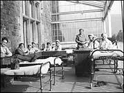 Patients from Adelina Patti Hospital era out on a balcony extension