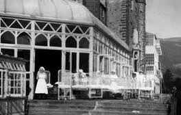 balcony outside Conservatory at haunted house Craig y Nos Castle, hospital children patients on trolleys on balcony South Wales