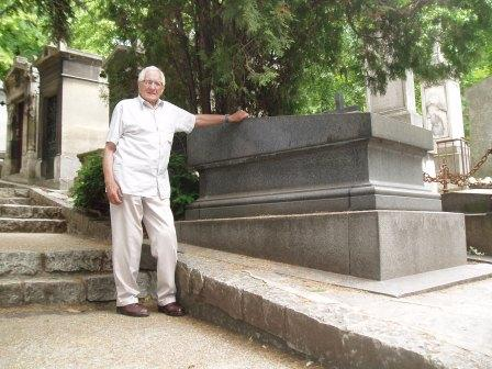 Len Ley, historian at Craig y Nos castle, South Wales, stands by Adelina Patti's grave in Paris Cemetary