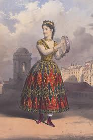 Adelina Patti in red and green patterned dress, holding cymbals