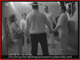 ghost hunters holding hands in a seance at craig y nos castle, wales