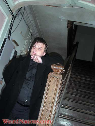 Steve Graham at Craig y Nos Castle haunted hotel in Wales by old staircase