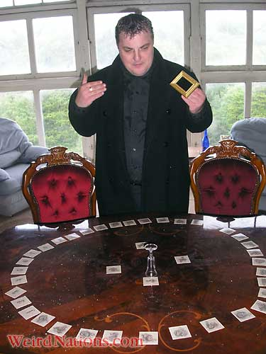Steve Graham at Craig Y Nos most haunted house card reading at seance table in Patti Boudoir