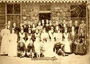 Former hospital staff gather for a group photo at Craig y Nos Castle, Wales